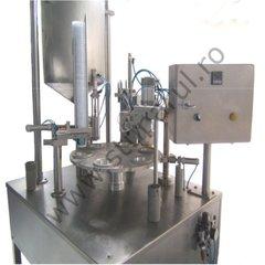 Masina pentru ambalat miere la caserola semiautomata